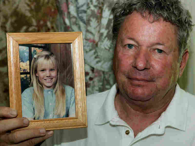 Carl Probyn, 60, holds a photo of his stepdaughter Jaycee Lee Dugard