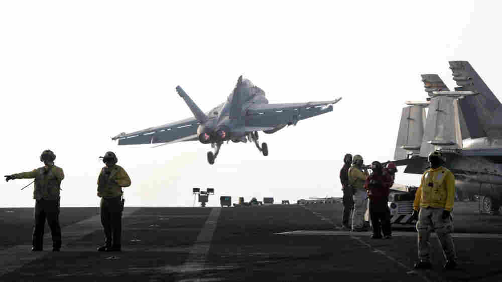 Wide: Hornet takes off from the USS Stennis in the Persian Gulf in 2007