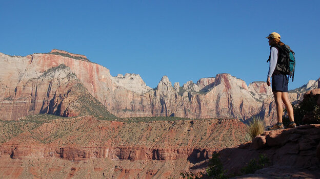 A hiker in Zion National Park (wide)