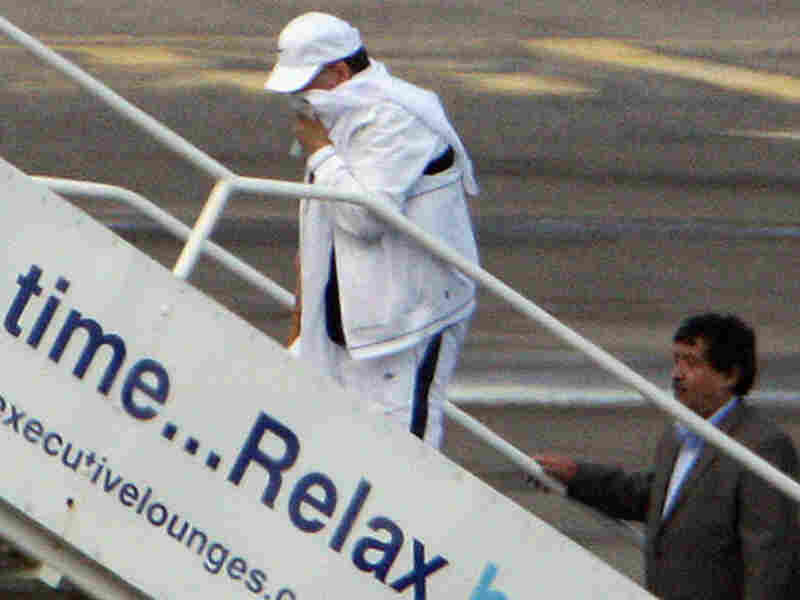 Lockerbie bomber Abdel Baset al-Megrahi walks on to his airplane