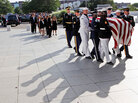 An honor guard carries the casket of Sen. Edward Kennedy