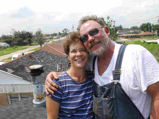 Colleen and Donald Bordelon on the roof of their home in August 2006.