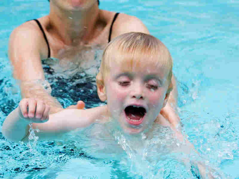 boy in swimming lesson