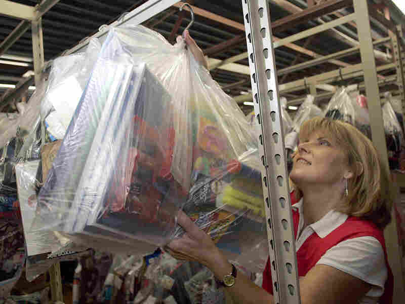 Tammy Wyatt hangs a bag containing back-to-school supplies that a Kmart customer has put on layaway.