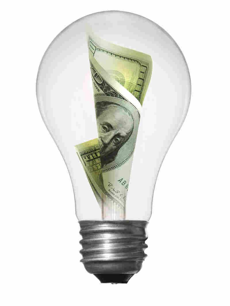 An illustration of a green-energy light bulb