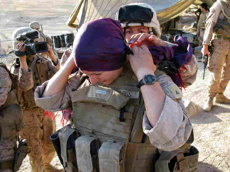 Marine Lance Cpl. Mary Shloss of Hammond, Ind., ties on her headscarf