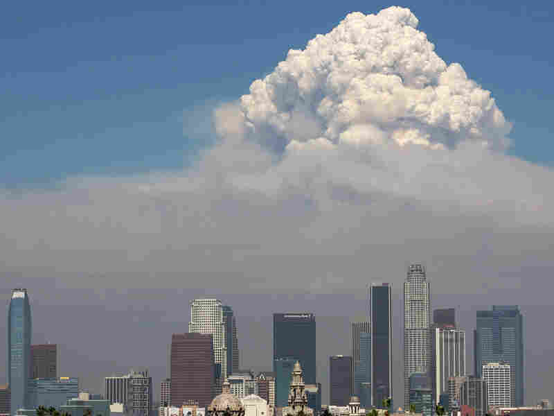 Smoke from the Station Fire towers over downtown Los Angeles on Monday.