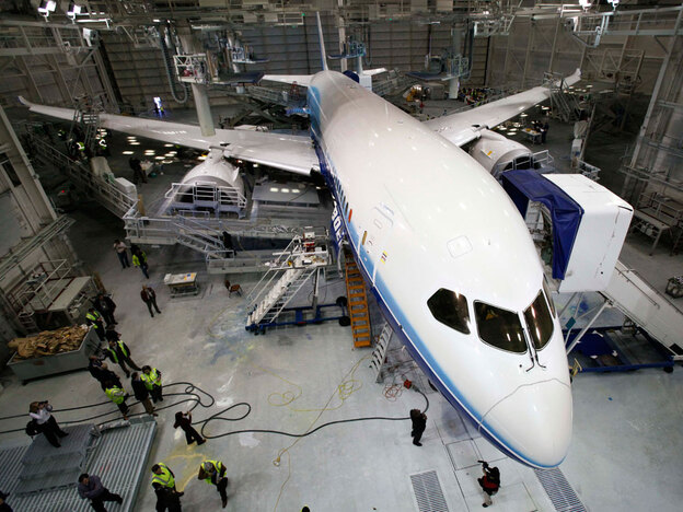 A Boeing 787 Dreamliner sits in a paint hangar at the plant in Everett, Wash. Despite fanfare over its debut, it has yet to have its first test flight. (AP)
