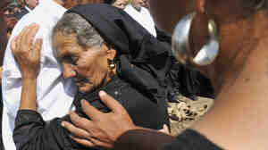 Wide: Mother mourns daughter's death in enthnic violence in Hungary.