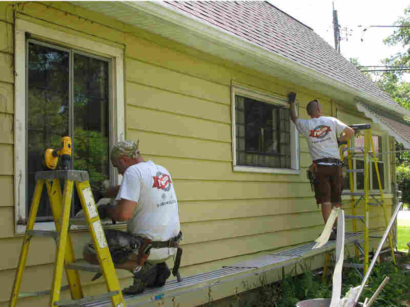 A work crew replaces old windows at a home in Illinois.