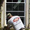 A worker installs a new window.