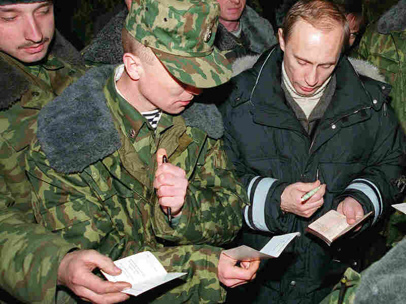 Vladimir Putin signs autographs for Russian soldiers, east of the Chechen capital, Grozny