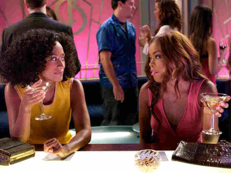 On the popular sitcom 'Girlfriends,' Joan (Tracee Ellis Ross) has a drink with Maya (Golden Brooks)