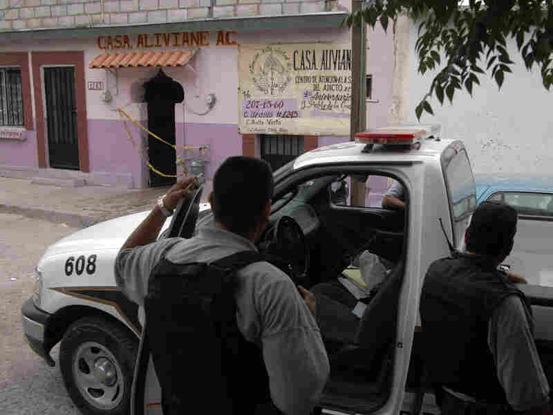 Police officials stand guard in front of a drug rehabilitation center in Ciudad Juarez, Mexico.