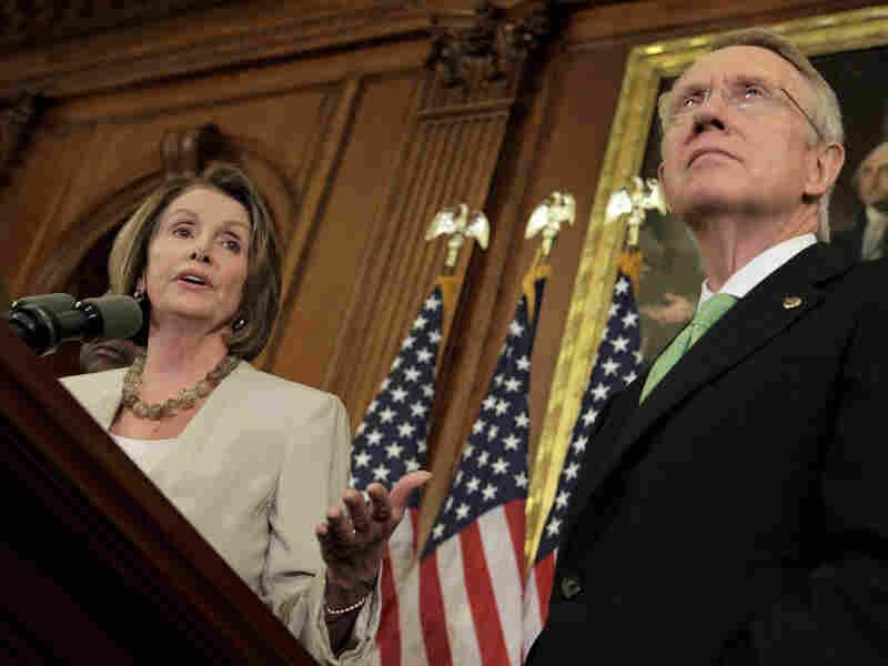 House Speaker Nancy Pelosi stands next to Senate Majority Leader Harry Reid in April 2009