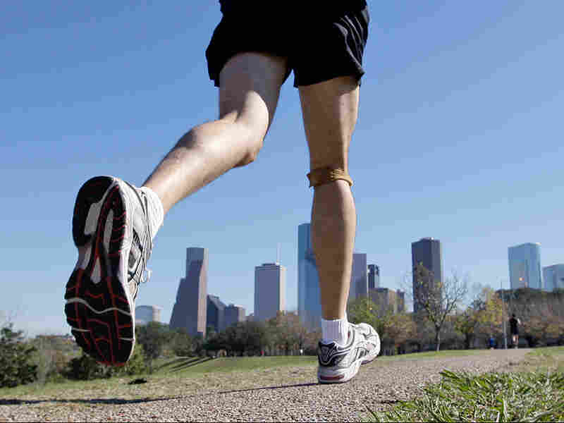 A jogger runs near downtown Houston.