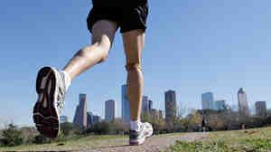 A man jogs near downtown Houston.