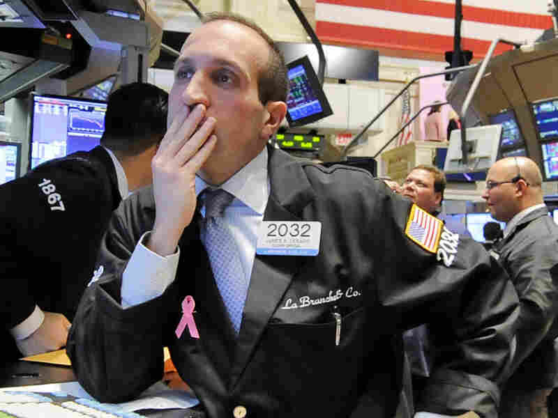 Specialist James Denaro works at his post on the floor of the New York Stock Exchange.