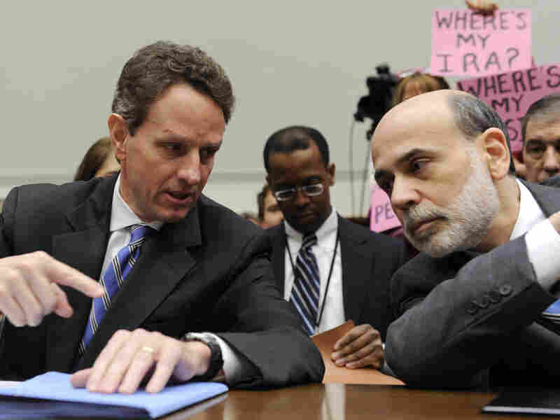 Treasury Secretary Timothy Geithner talks with Fed Chairman Ben Bernanke.