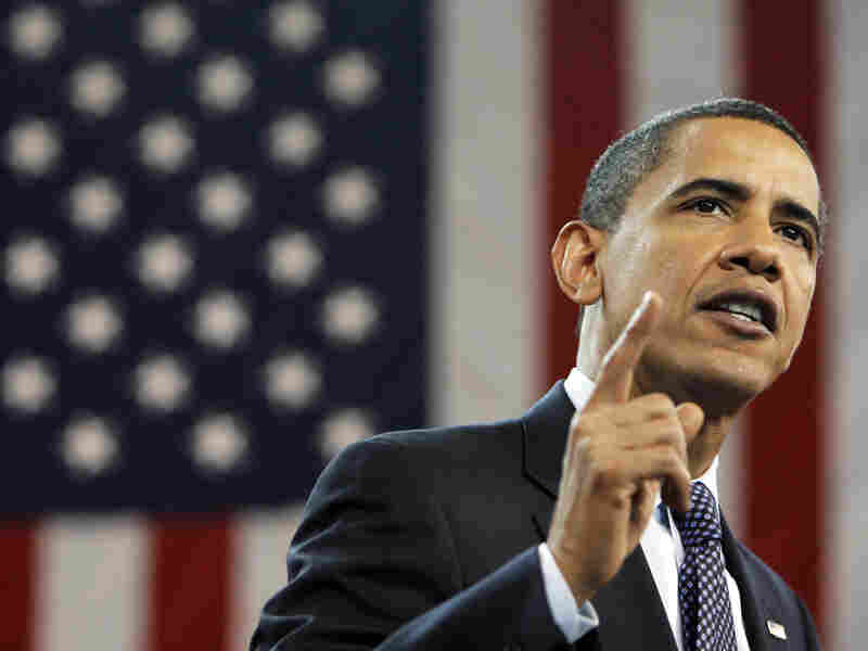 President Obama gestures during a town hall on health care reform in July.