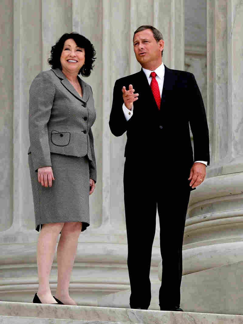 Sotomayor escorted by Chief Justice John Roberts