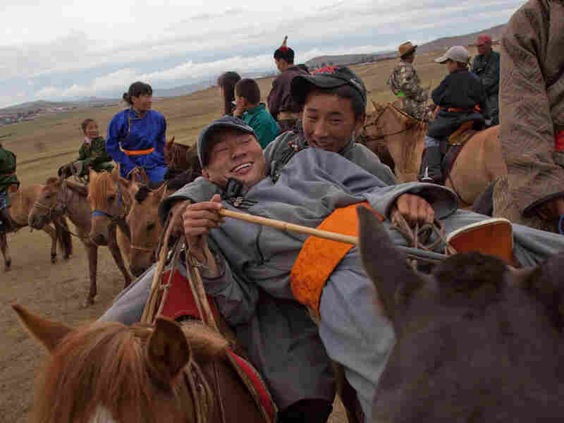 At the finish line for horse-racing competition in Khujirt, Mongolia