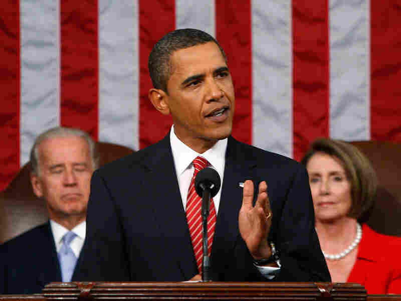 President Obama addresses Congress as Vice President Biden and House Speaker Nancy Pelosi look on.