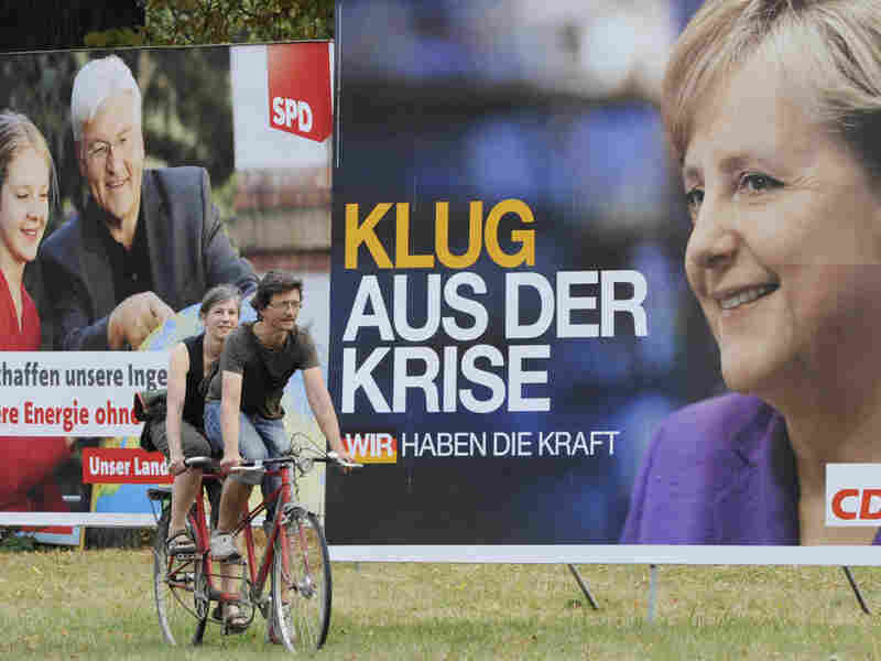 Election posters of German Chancellor Angela Merkel (right) and challenger Frank-Walter Steinmeier