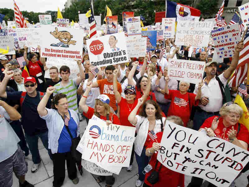 Protesters rally at Freedom Plaza in Washington Saturday. Jose Luis Magana/AP