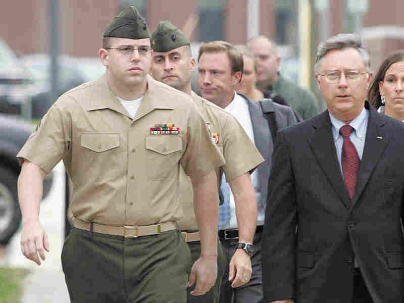 Cpl. Matthew Nelson, left, walks to court. Don Bryan/The Daily News/AP