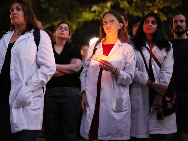 Doctors and other supporters of health care overhaul attend a candlelight vigil in New York City in September 2009.  The gathering was one of hundreds nationwide honoring those suffering under the current health care system.