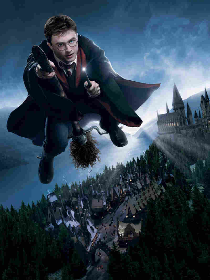 The character Harry Potter flying on a broomstick.