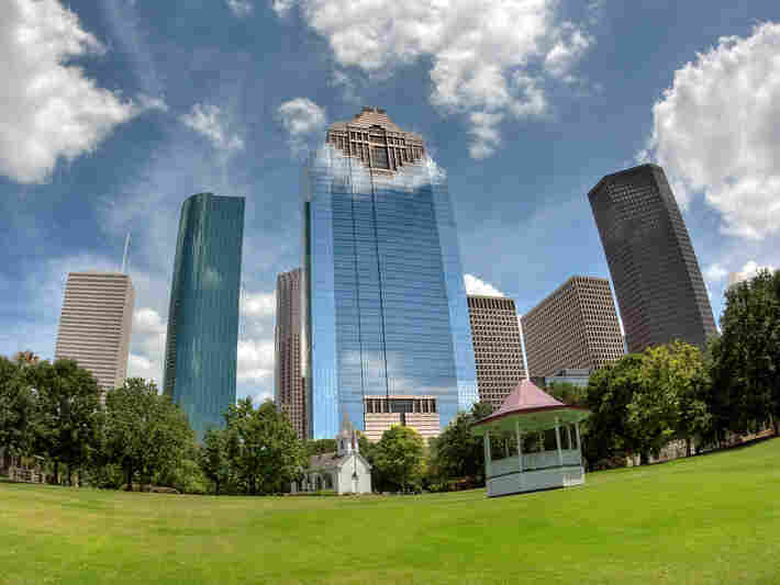 Houston's downtown skyscrapers loom at the edge of the 20-acre Sam Houston Park, near City Hall.