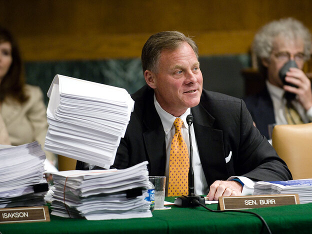 Richard M. Burr (R-NC), surrounded by copies of a proposed bill, during the first day of the Senate Health, Education, Labor and Pensions markup of comprehensive health care legislation.