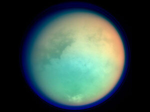 Titan has a very large atmosphere that extends hundreds of kilometers above it's surface.