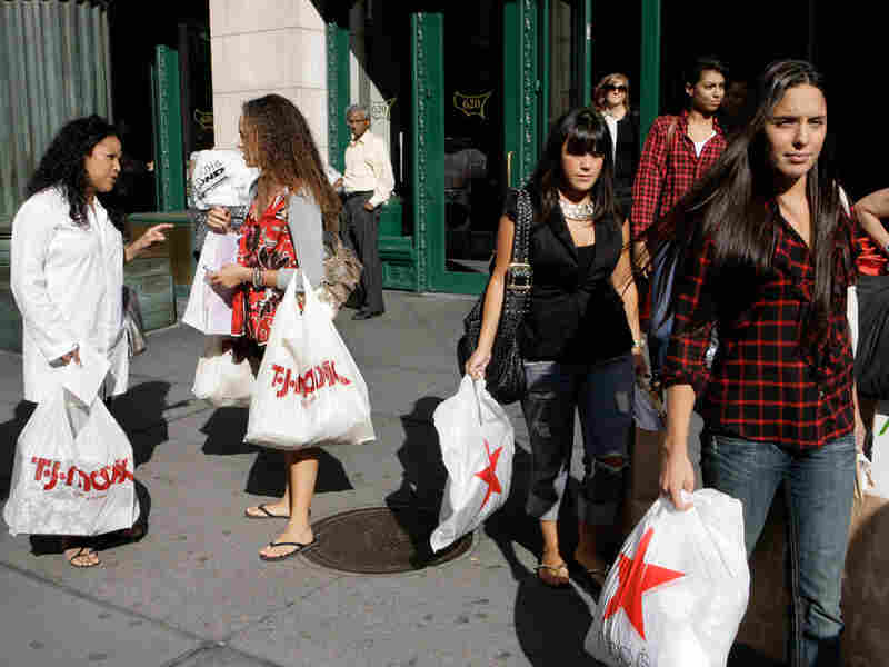 Shoppers leave a mall in New York, Aug. 31.