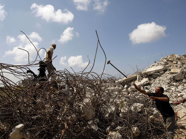 A Palestinian family clears rubble near their house that was destroyed in Israel's offensive in Gaza. Israel on Wednesday rejected U.N. calls for an independent inquiry into its conduct in last winter's Gaza conflict.