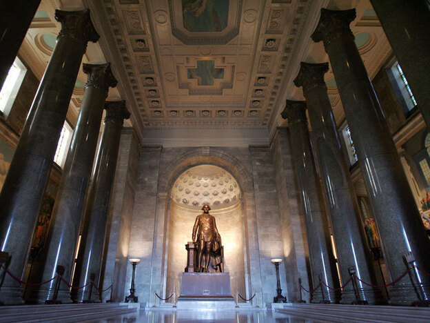 A bronze statue of George Washington — who, along with a dozen other U.S. presidents, was a member of the Freemasons — stands in the George Washington Masonic Memorial in Alexandria, Va.