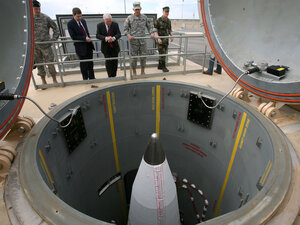 Defense Secretary Robert Gates and others inspect a missile facility.