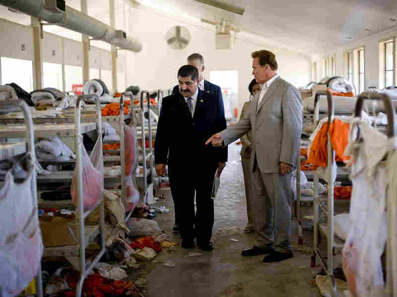 Gov. Arnold Schwarzenegger tours a California prison where a riot recently took place.