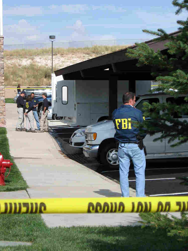 Federal agents stand outside the suburban Denver apartment building where Najibullah Zazi lives.