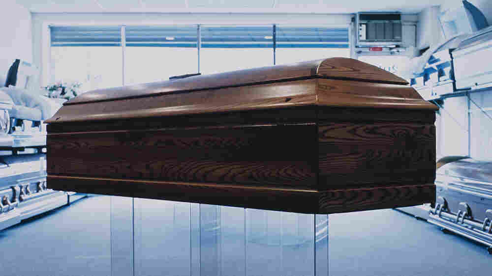 (Wide) A coffin on display in a showroom.