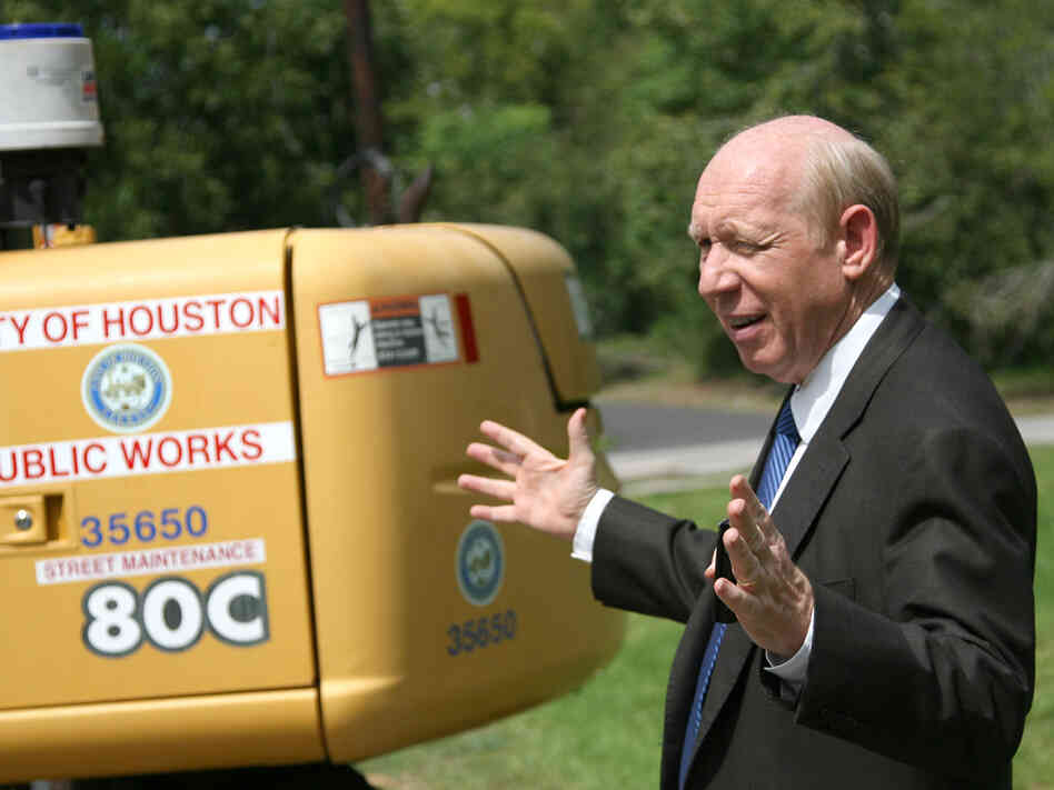 Houston Mayor Bill White gestures during a visit to a construction site.