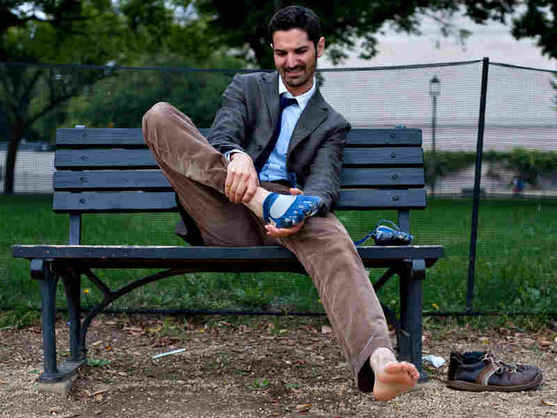 Host Guy Raz takes the shoes off after a test run. Ryan Gibbons/NPR