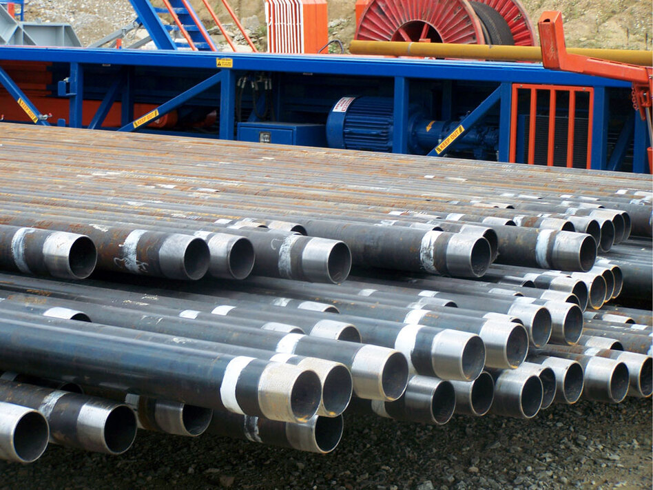 A shale gas well bore is lined by steel pipe, shown here in 100-foot sections in Washington County, Pa., at the drill site of Range Resources. Between its vertical and horizontal sections, a well bore will extend 9,000 feet or longer and require more than a million pounds of steel.