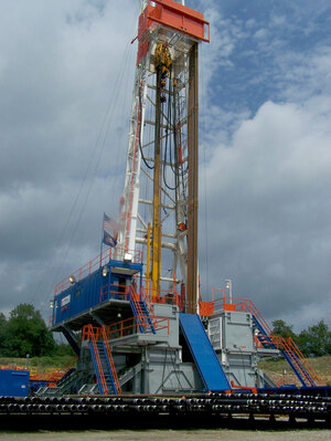 A deep drilling rig at the site of a shale rock formation in southwestern Pennsylvania. The rig, which was set up by Range Resources, a leading shale gas player, serves as a brace to support the drill.