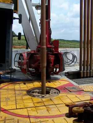 The drilling platform on a shale gas drilling rig. The shaft in the center is turning a drill bit deep underground. The drilling operation continues 24/7.