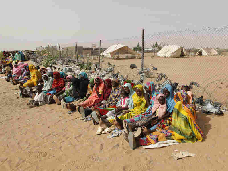 Displaced Sudanese women and children seek medical treatment at Abu Shouk refugee camp