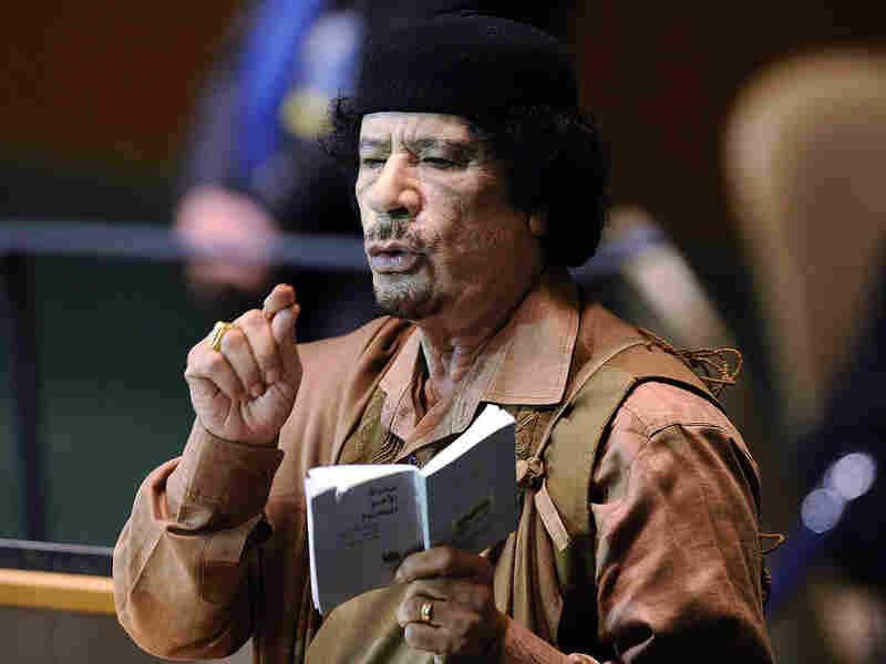 Libyan leader Col. Moammar Gadhafi holds a copy of the U.N. charter.