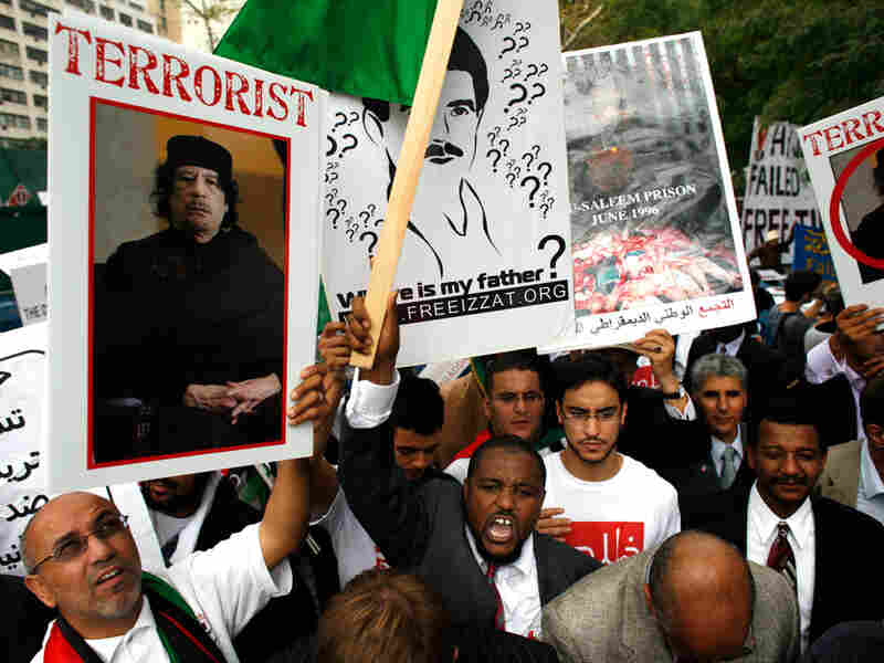 Demonstrators rally against Libyan leader Moammar Gadhafi across the street from U.N. headquarters.